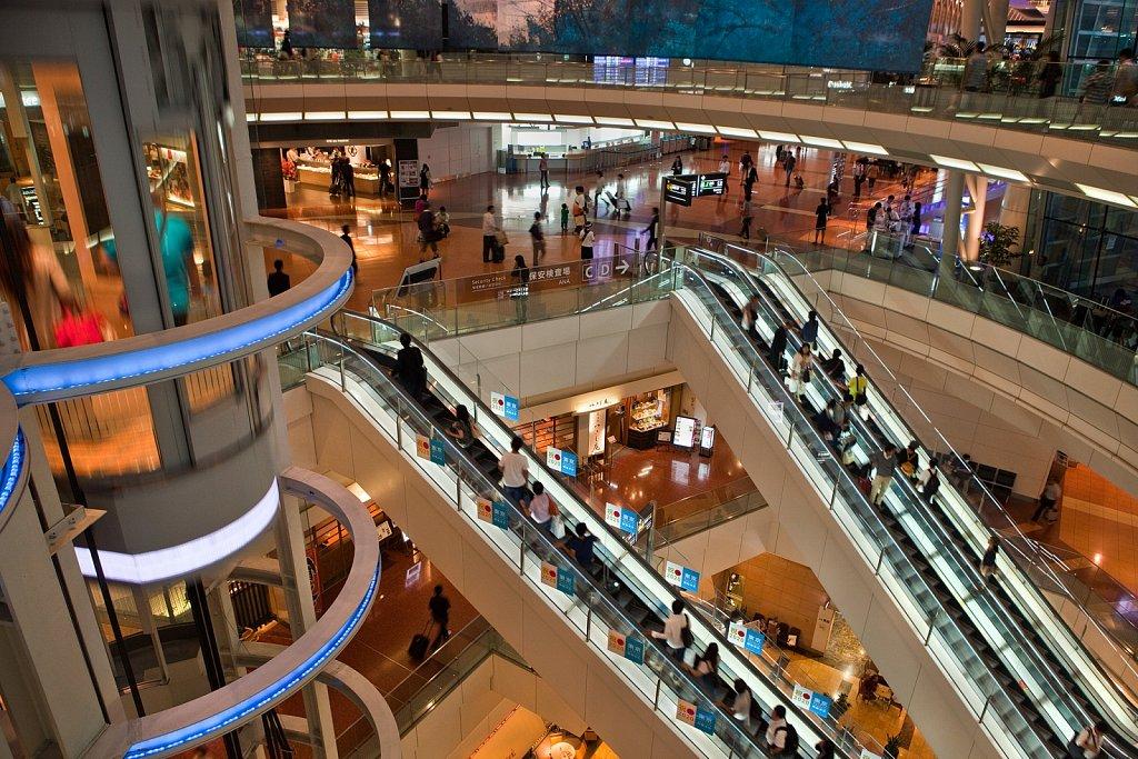 Interior of terminal, escalators and elevators at Haneda Airport, Tokyo, Japan
