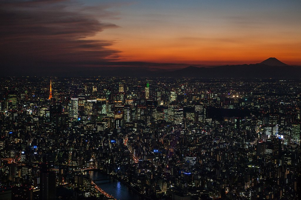 Tokyo Skytree top level sunset view to south west with view of Tokyo Tower and Mt Fuji in Oshiage, Tokyo, Japan