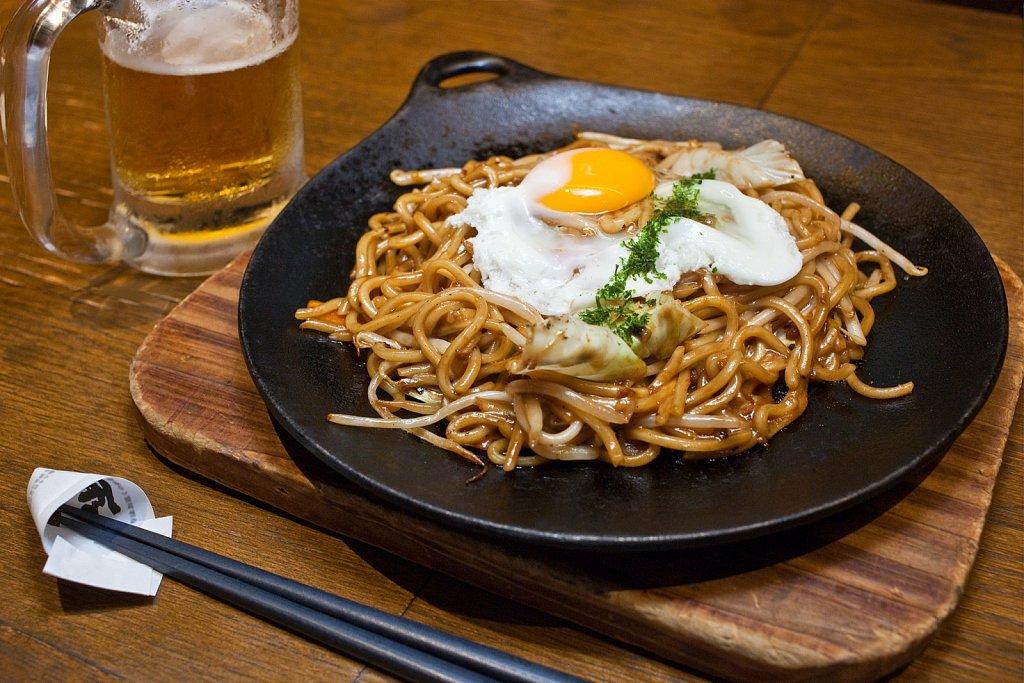 Beer and yakisoba fried noodles in Gotanda, Tokyo, Japan