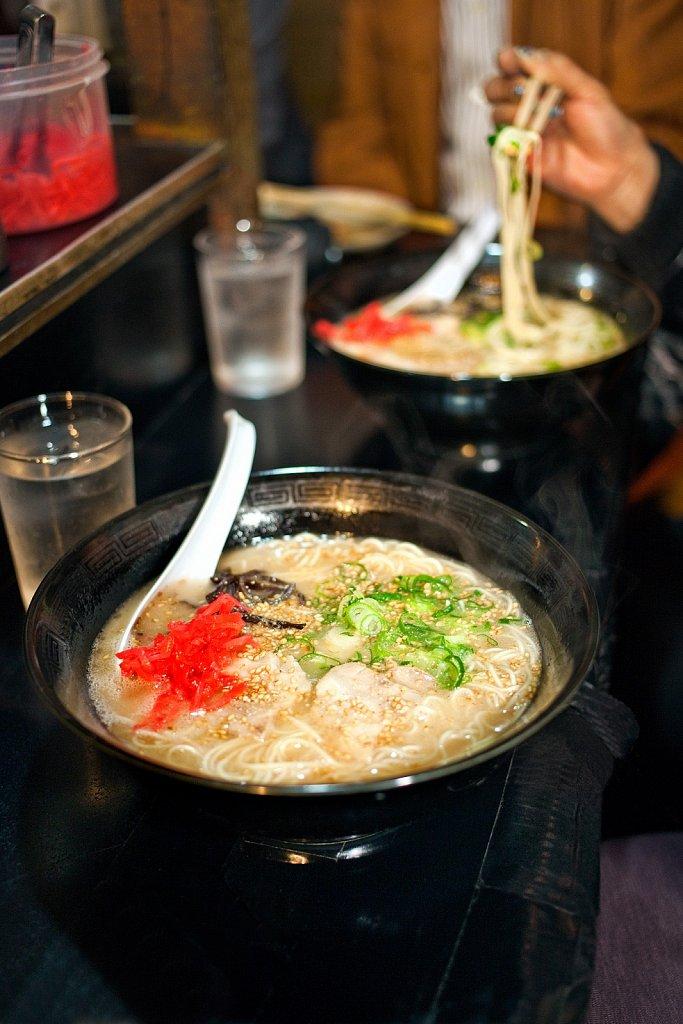 Eating ramen noodles at Yatai, mobile food stall, in Fukuoka, Kyushu, Japan