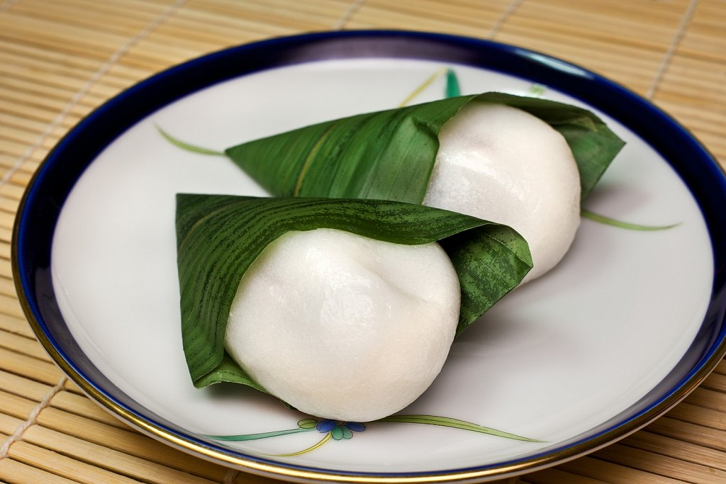 Mochi, pounded rice, wrapped in bamboo leaf for tea time dessert in Nakaikegami, Tokyo, Japan