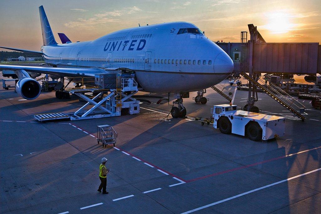 747 jetliner loading at gate at Narita International Airport in Narita, Japan