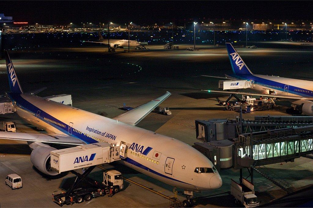 Aircraft loading at the gate in the evening at Haneda Airport, Tokyo, Japan