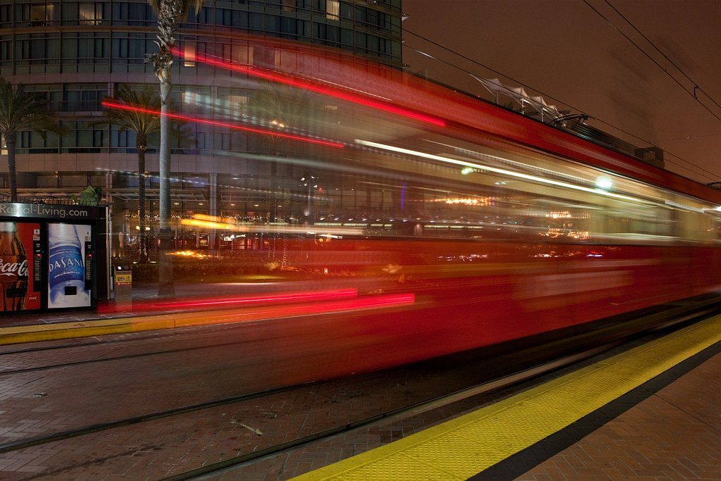 Blur of departing trolley in the evening in San Diego, California