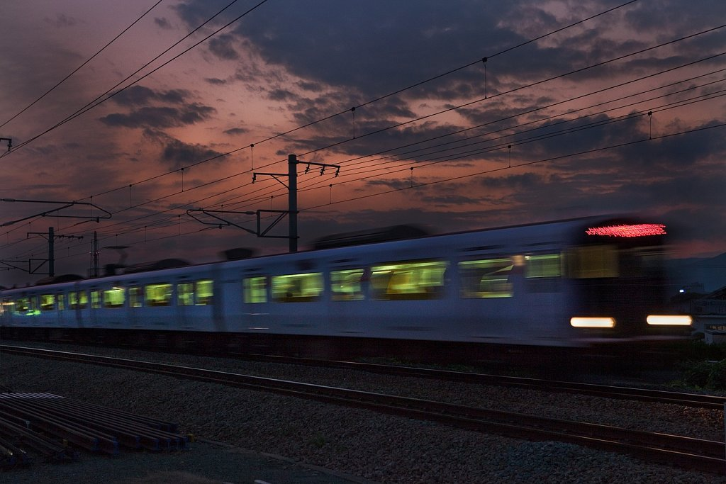 Blur of regional train at dusk in Tosu, Saga, Japan