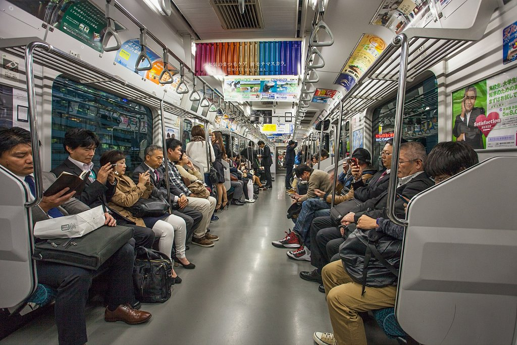 Train interior and commuters in Tokyo, Japan