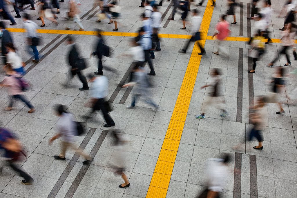 Motion blur of train passengers at Shinagawa Station in Shinagawa, Tokyo, Japan