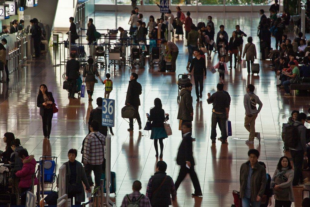 Passengers at flight check area in Haneda Airport, Tokyo, Japan