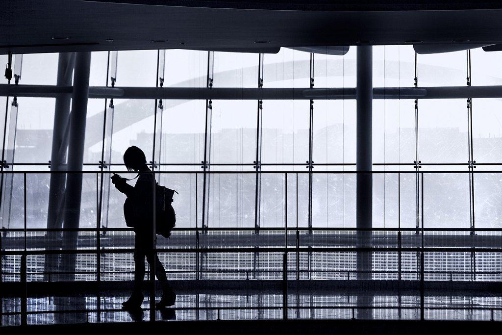 Silhouette of photographer at Haneda Airport, Tokyo, Japan
