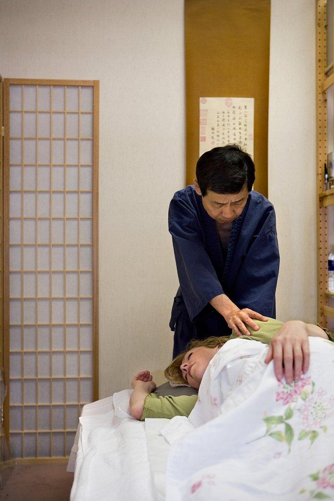 Woman receives Japanese shiatsu massage treatment