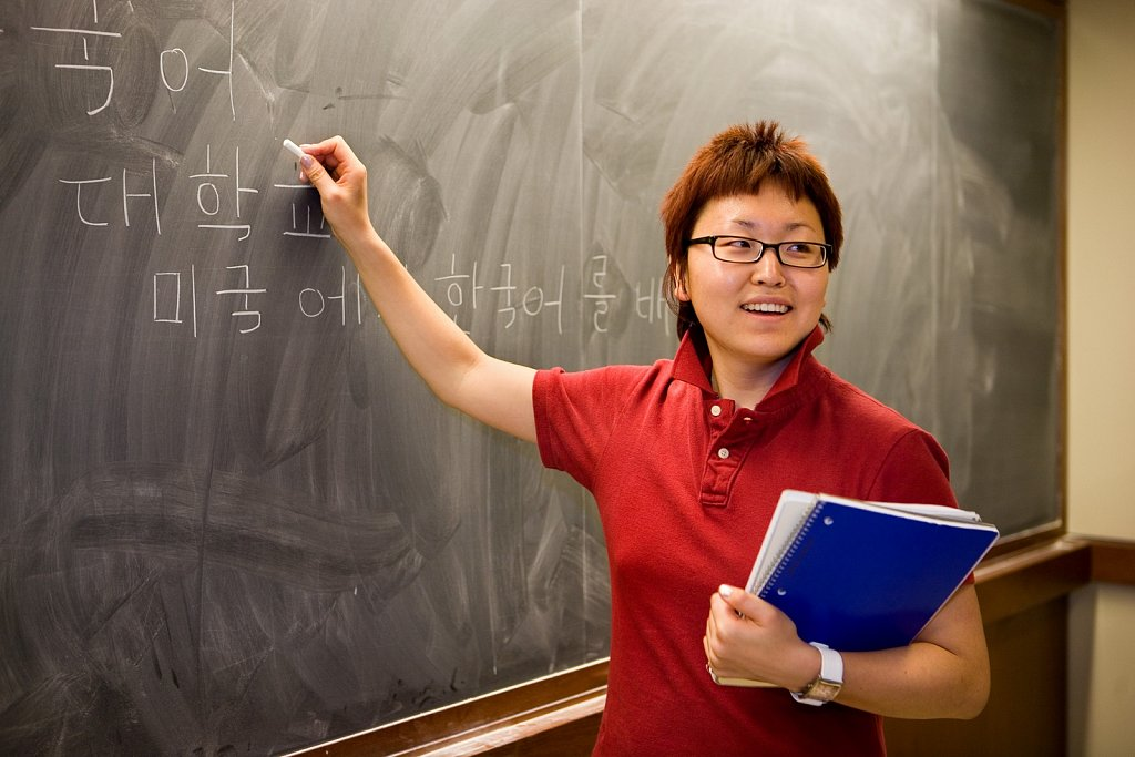 Asian graduate student at blackboard