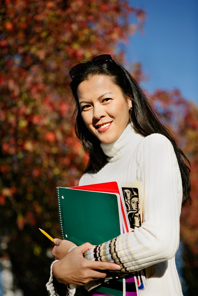 Graduate student with autumn leaves