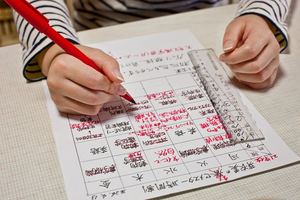 Woman student makes college class schedule in Tosu, Saga, Japan