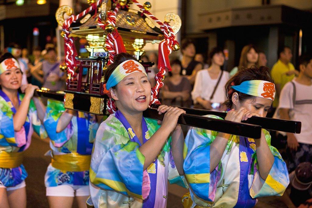 Women carry mikoshi (portable shrine) at Awa Odori Festival in Kagurazaka, Tokyo, Japan