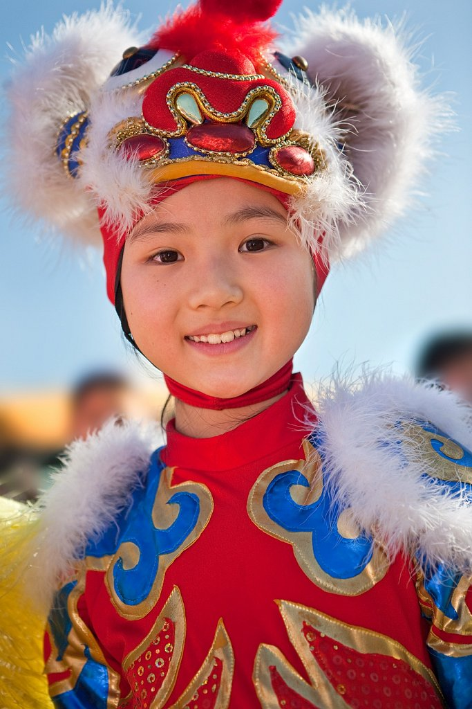 Young girl as dragon dancer at Chinese New Year parade in Los Angeles