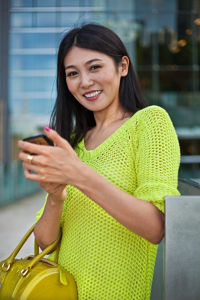 Young Asian woman with cell phone, Tokyo, Japan