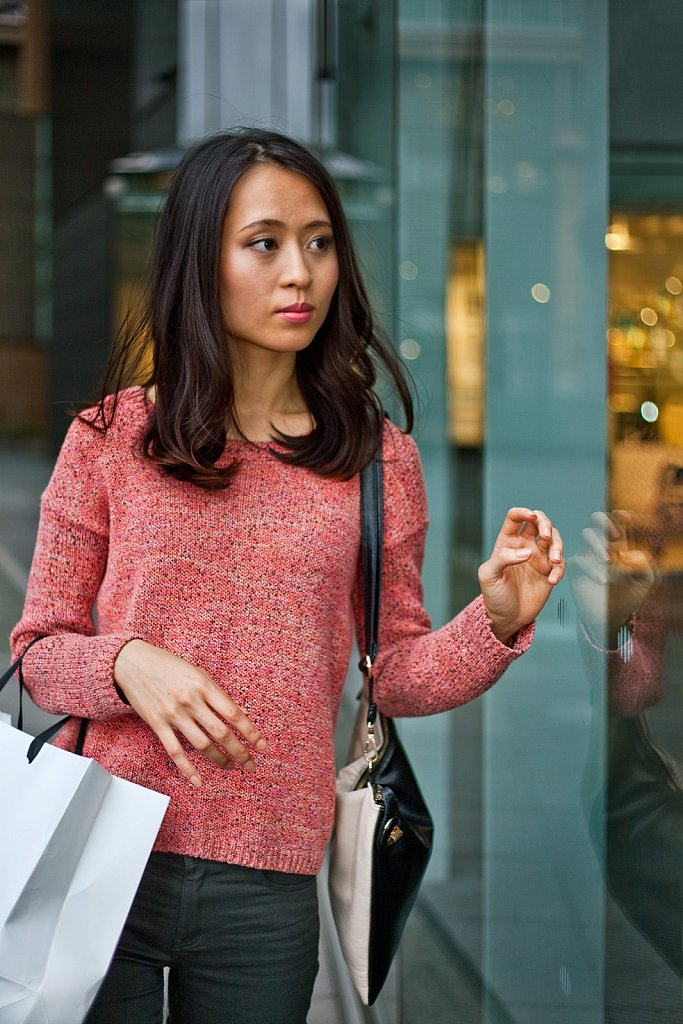 Young Asian woman is window shoping in, Tokyo, Japan