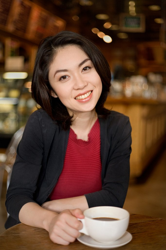 Young Japanese woman in a coffee shop