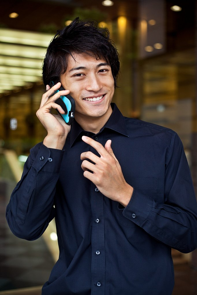 Young man with cell phone in Tokyo, Japan