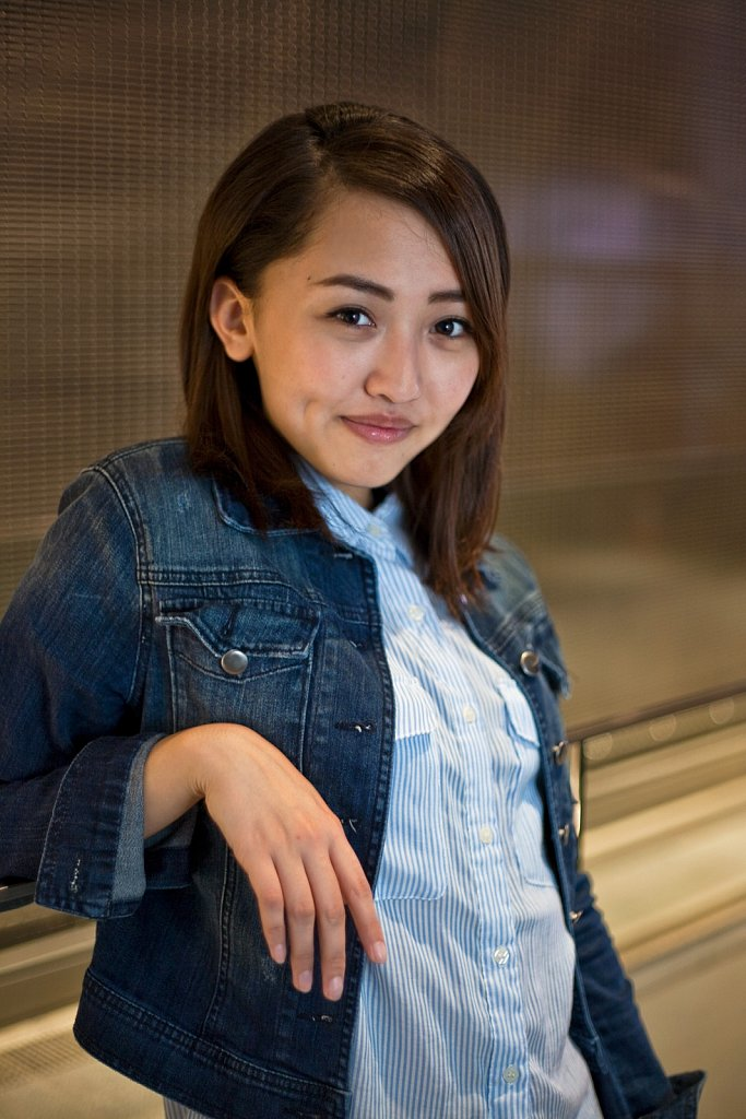 Young woman in jean jacket in Ginza, Tokyo, Japan