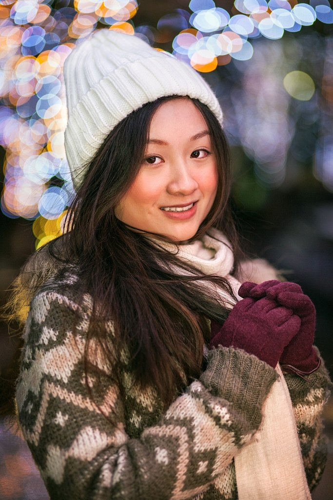 Young woman in sweater at holiday lighting in Roppongi, Tokyo, Japan