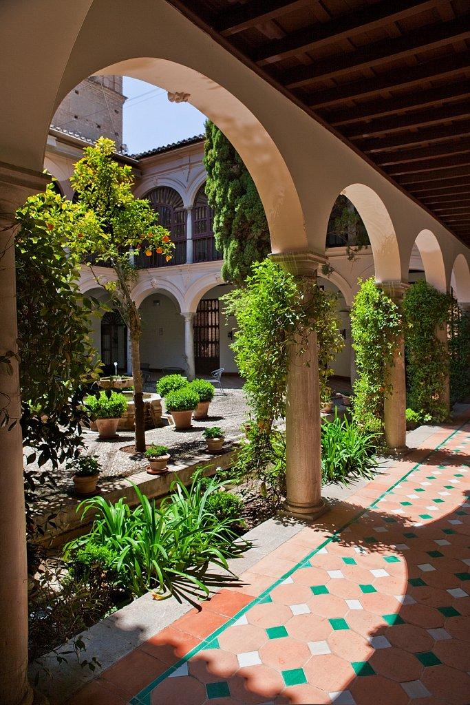 Parador San Francisco garden courtyard, 15th century, at The Alhambra in Granada, Spain
