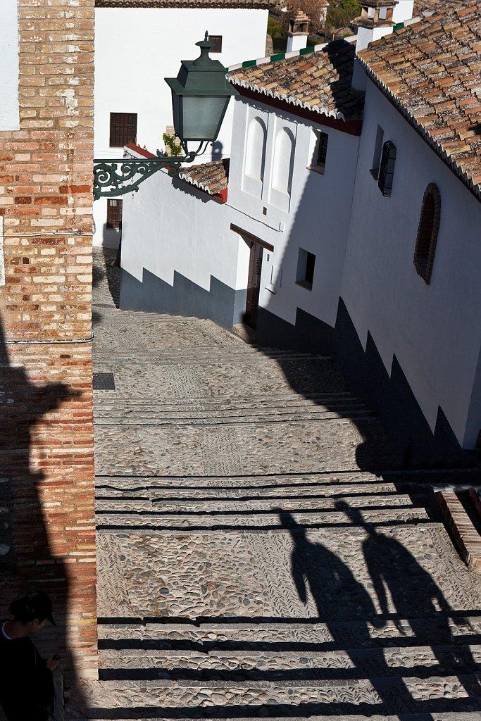 Pedestrian shadow in Albaicin area, Granada, Spain