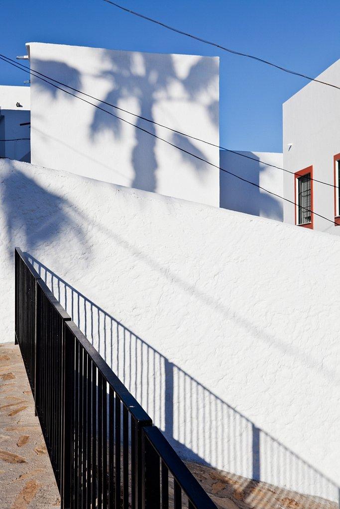 Railing and tree shadows in Salobrena, Spain