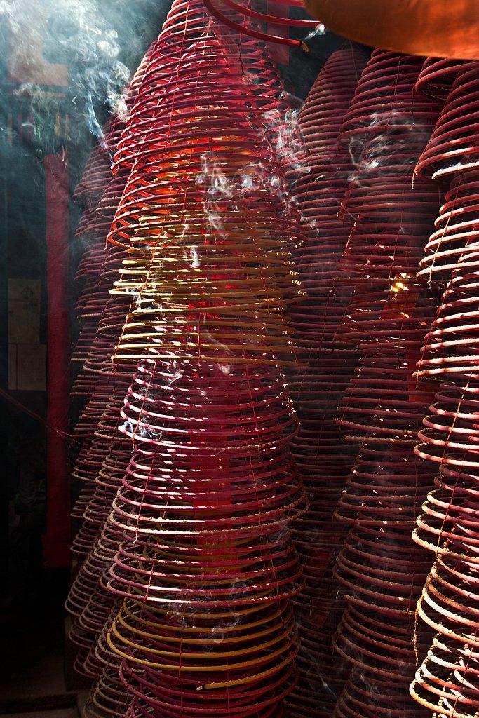 Incense coils hanging from smoky ceiling at Tin Hau Temple in Kowloon, Hong Kong, China