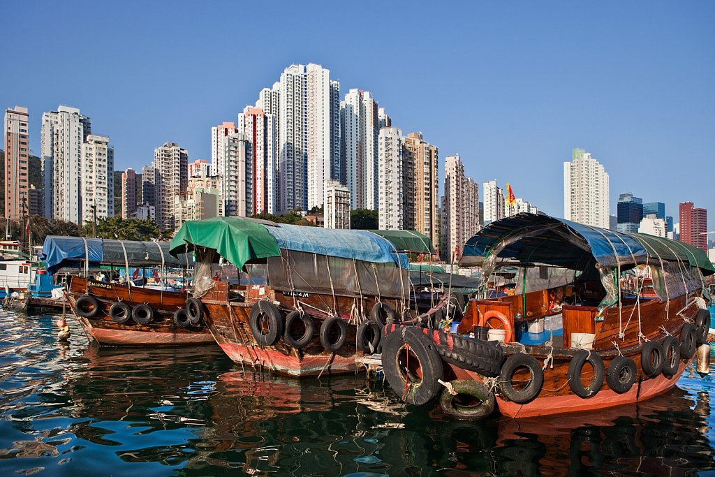 Junks in harbor and high rise residences in Aberdeen, Hong Kong, China