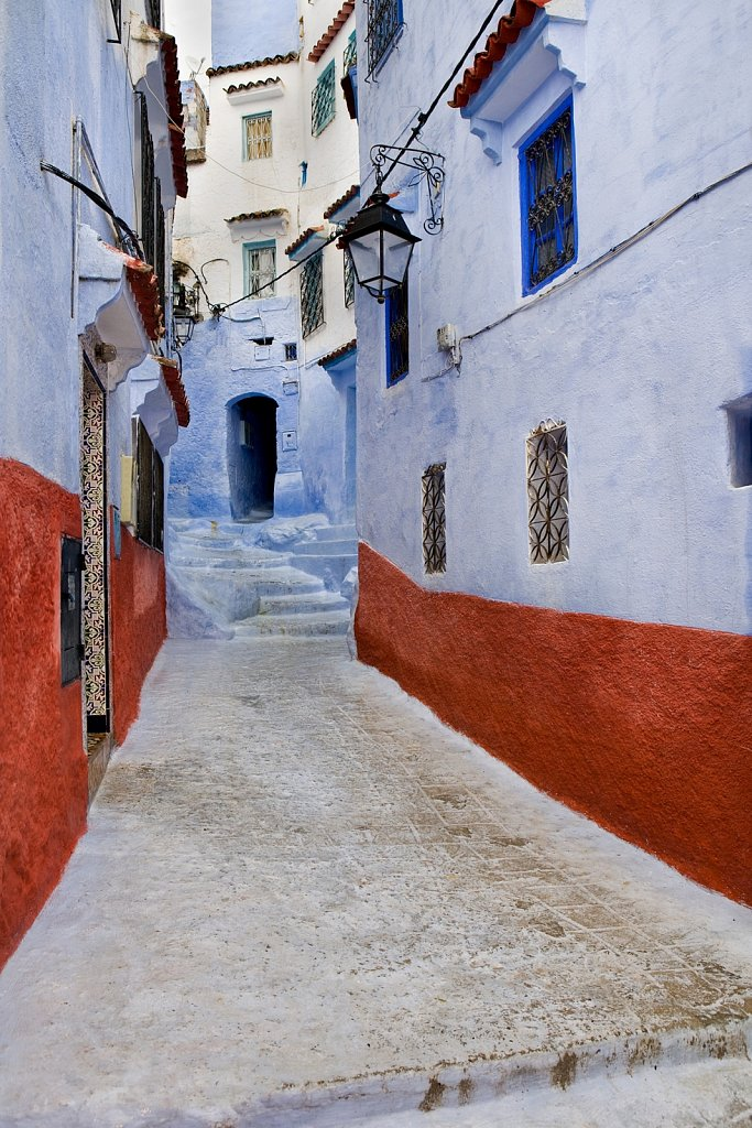 Narow street with steps in Chefchaouen, Morocco