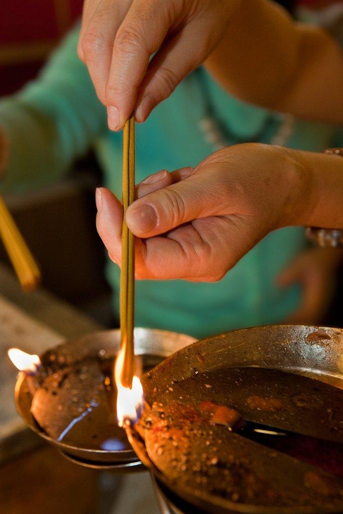 Worshipers light candles and incense at Man Mo Temple in Hong Kong, China