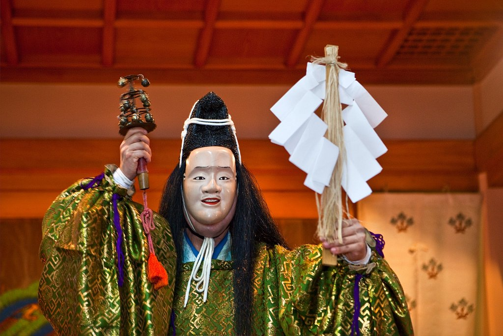Actor on onstage in Folk Kagura (Shinto theatrical dance) at Takadanobaba obon festival in Tokyo, Japan