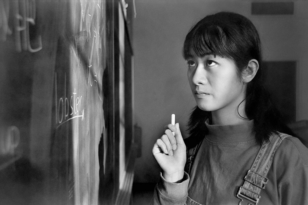 Young Chinese woman at blackboard