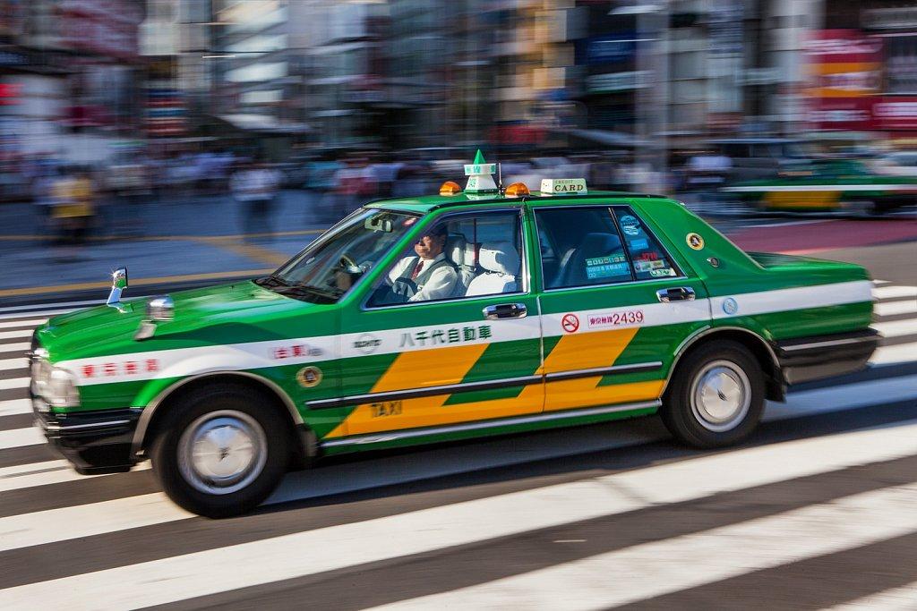 Blur of passing taxi in Shibuya, Tokyo, Japan
