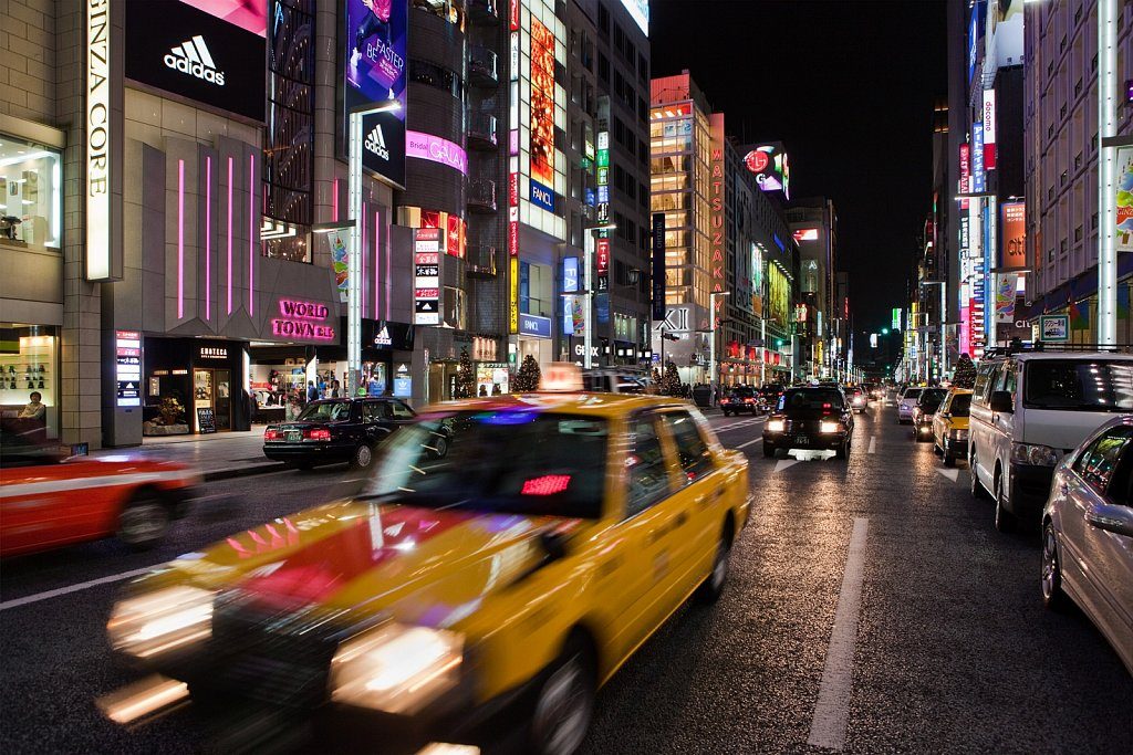 Blur of passing taxi in Ginza, Tokyo, Japan