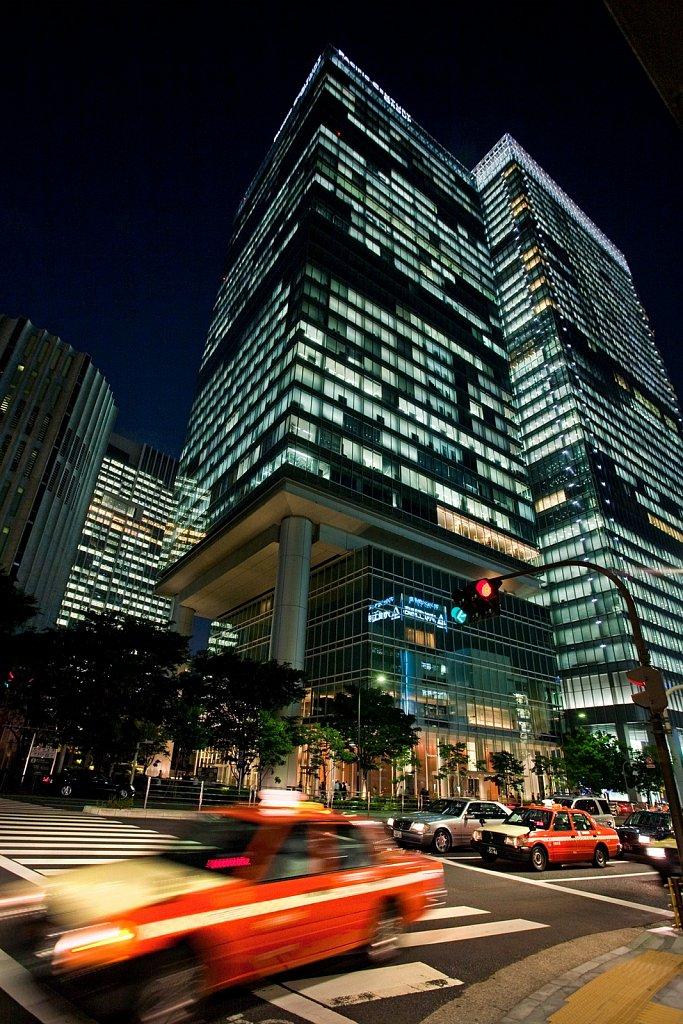 Blur of passing taxi in Marunouchi, Tokyo, Japan