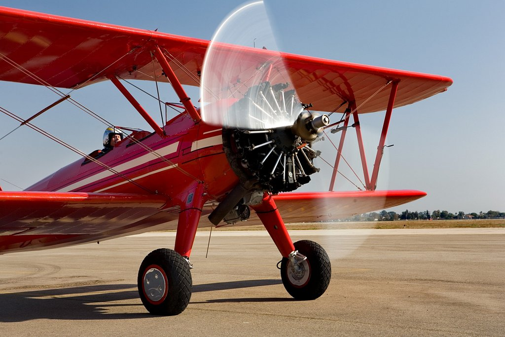 Red Stearman Biplane Take-off