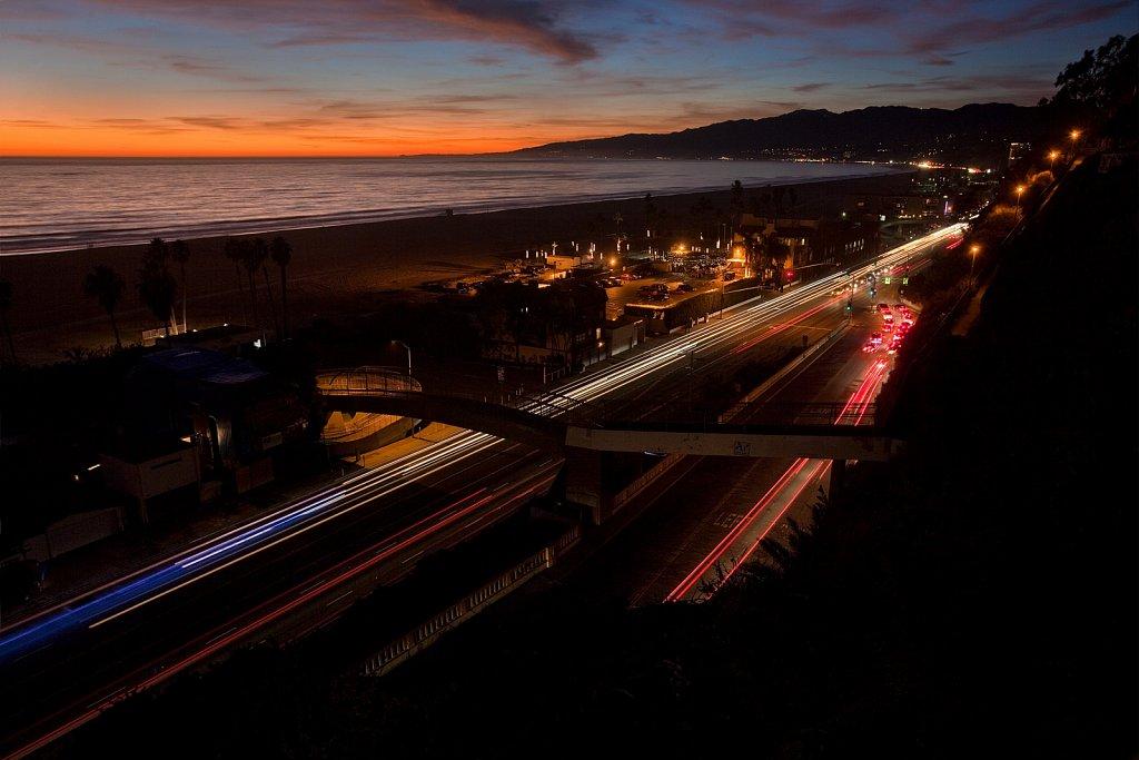 Sunset, traffic, and Santa Monica Palisades in Santa Monica, California